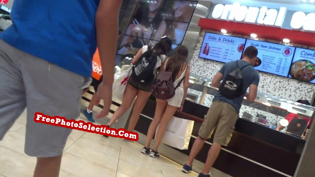 Gorgeous teen girl filmed by voyeur in shopping mall fast food